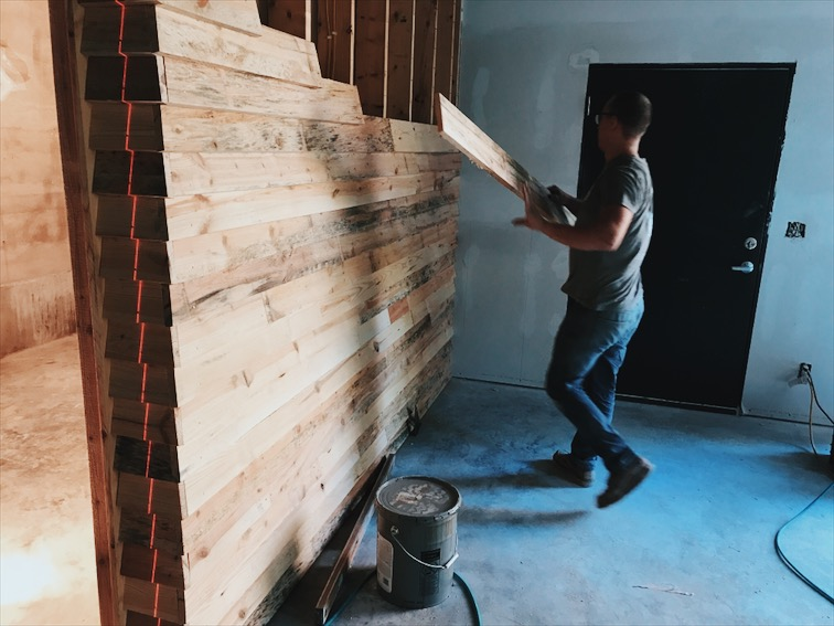 Aaron and I cladding my office with the site sawn pine siding. Note the laser line, every nail was perfectly aligned because I am crazy.