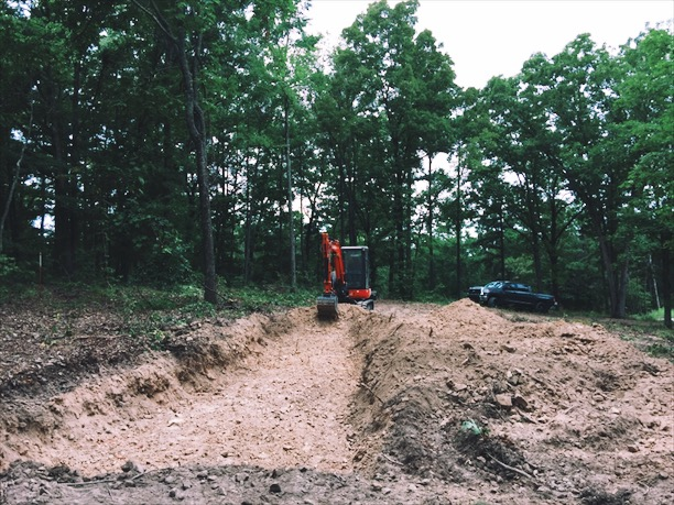 Prepping the site for the studio build. We had to bring in a backhoe to hammer out 3' x 100'of bedrock for the footing. Fun fact, I was swarmed by a nest of yellow-jackets about an hour after this photo was taken. They were by the tree next to my truck. The next day I laughed maniacally as I poured diesel on their nest and watched their world burn. A bit much? Maybe, but I hate yellow-jackets.
