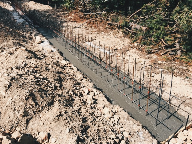 Concrete poured into the footing with steel for the stem wall. Steel is real, and I really put in a lot of it.