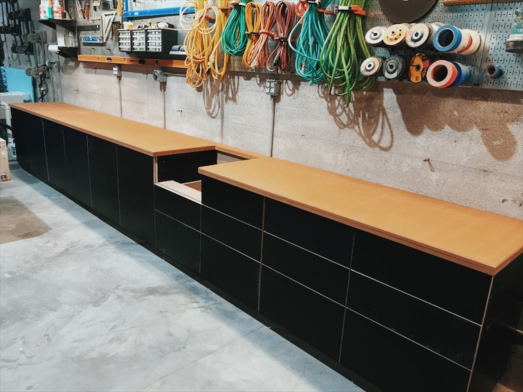Here they are installed with an oiled MDF countertop. The cabinets are made from black concrete form-ply, a nod to the forms used to create the rammed earth walls.