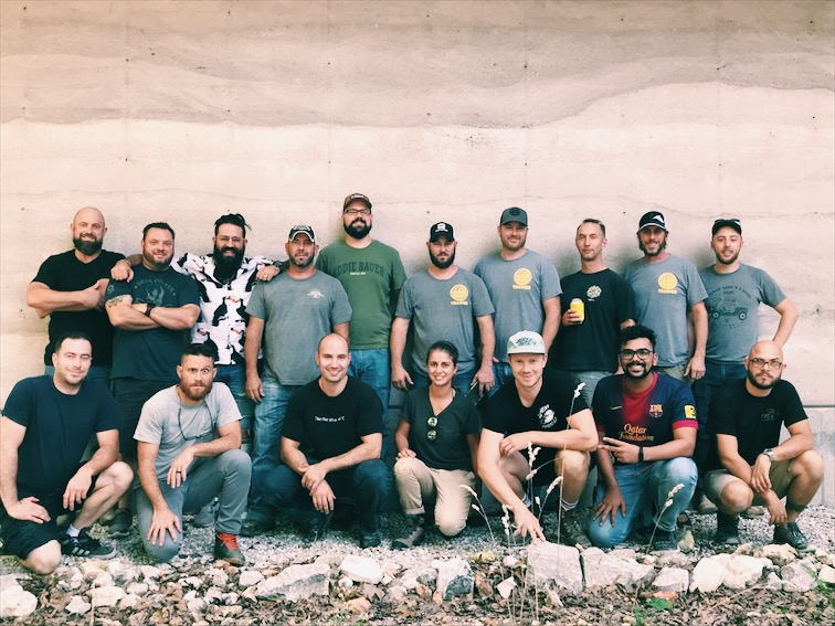 Attendees of the September 2018 DustyCrete Workshop - check out that rammed earth behind them!