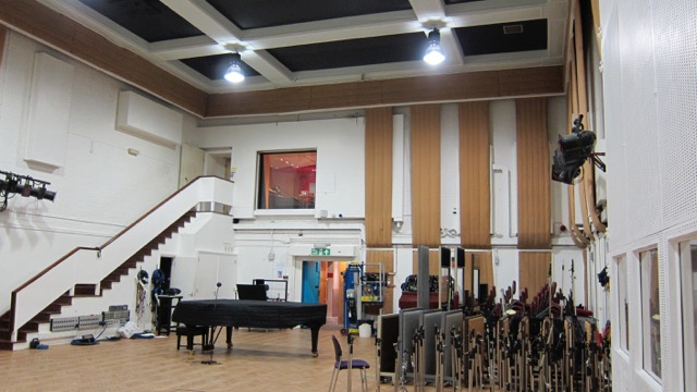 Abbey Road Studio #2, where The Beatles recorded most of their songs, with producer George Martin at the recording console in the control room at the top of the stairs.