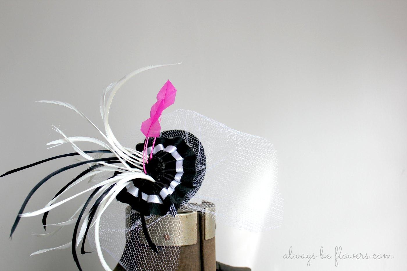 A fascinator designed for a black and site striped dress