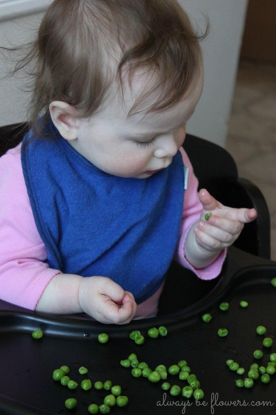 Picking up peas helps develop fine motor skills.