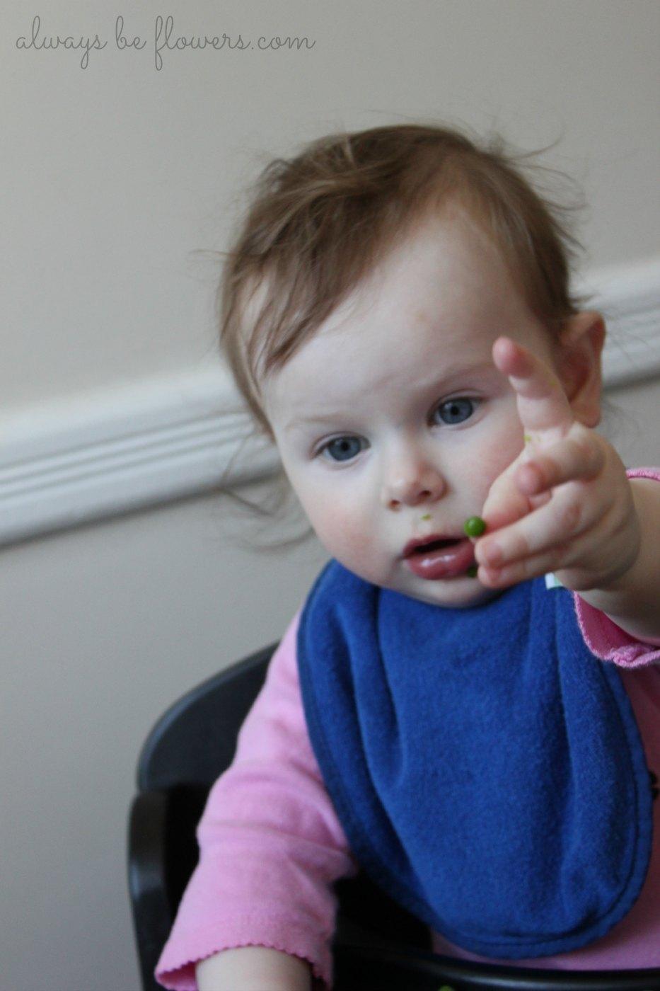 baby-eating-showing-peas.jpg
