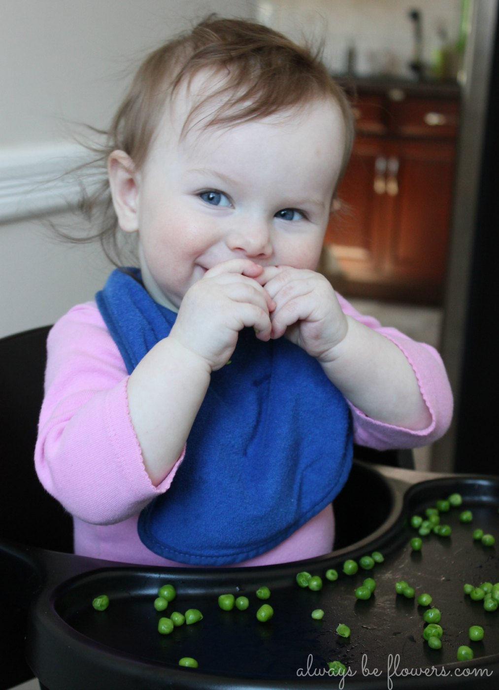 baby-happy-eating-peas.jpg
