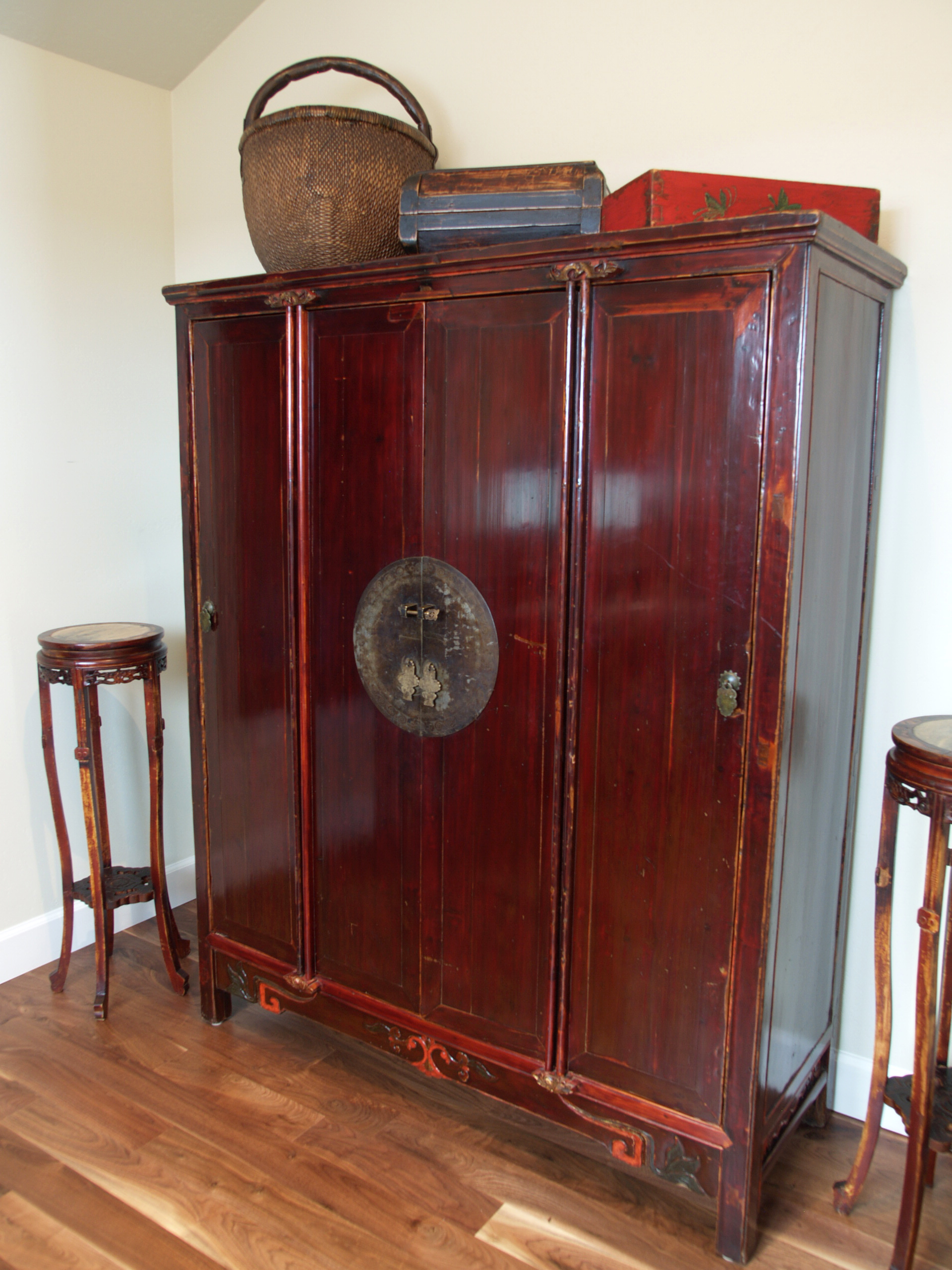 large armoire with marble plant stands