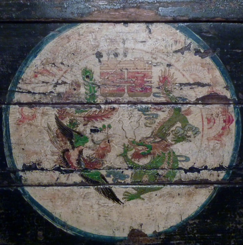 peacock and dragon motif on a wedding chest