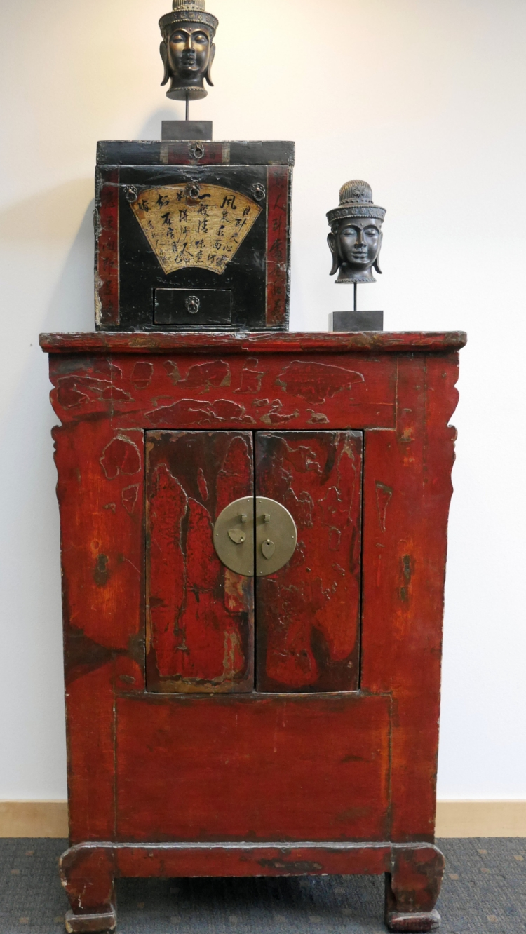Classic red cabinet with Mongolian Trunk in the ERA/Lambros Bldg. in Missoula