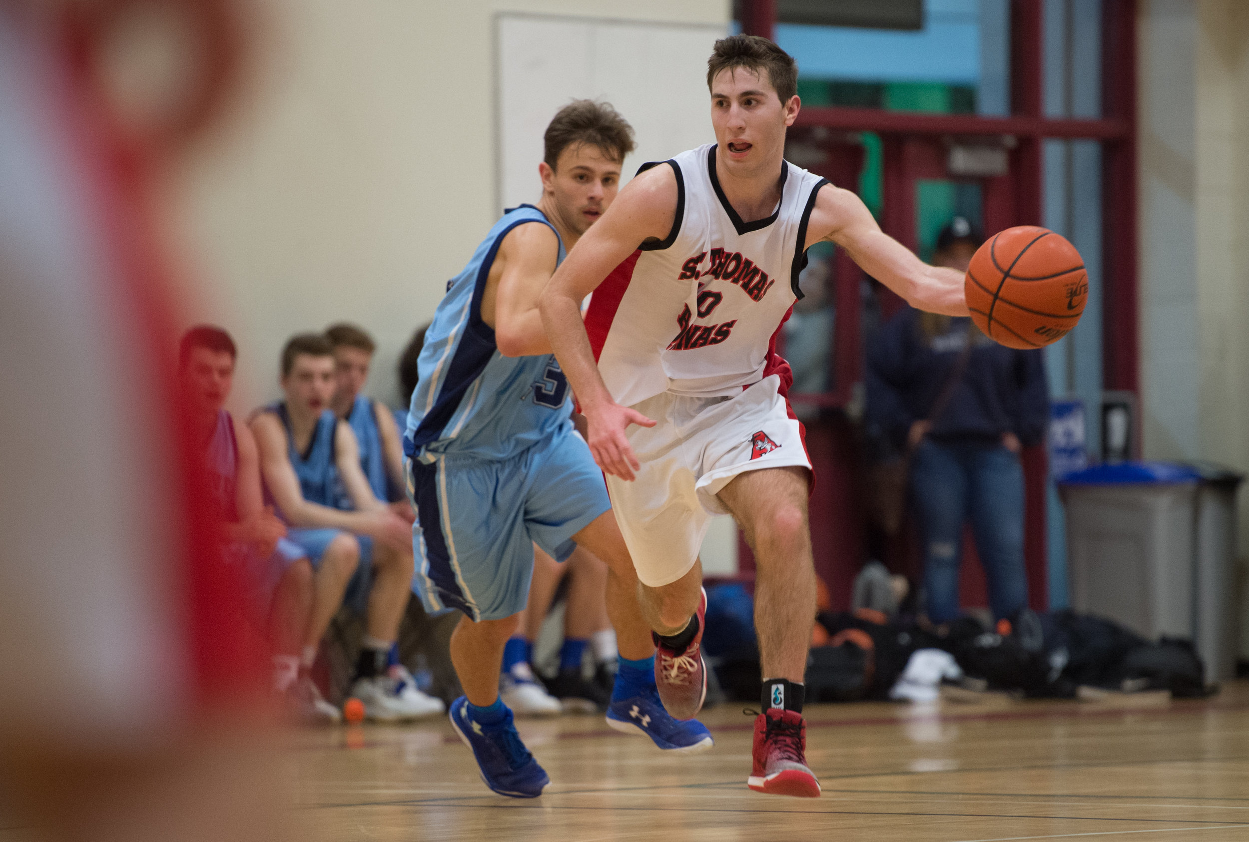 Matteo Botteselle drives through midcourt in STA's 94-78 victory over the Seycove Seyhawks.  Botteselle was awarded the No Regrets Player of the Game for his efforts in the Howe Sound AA Championship Game.