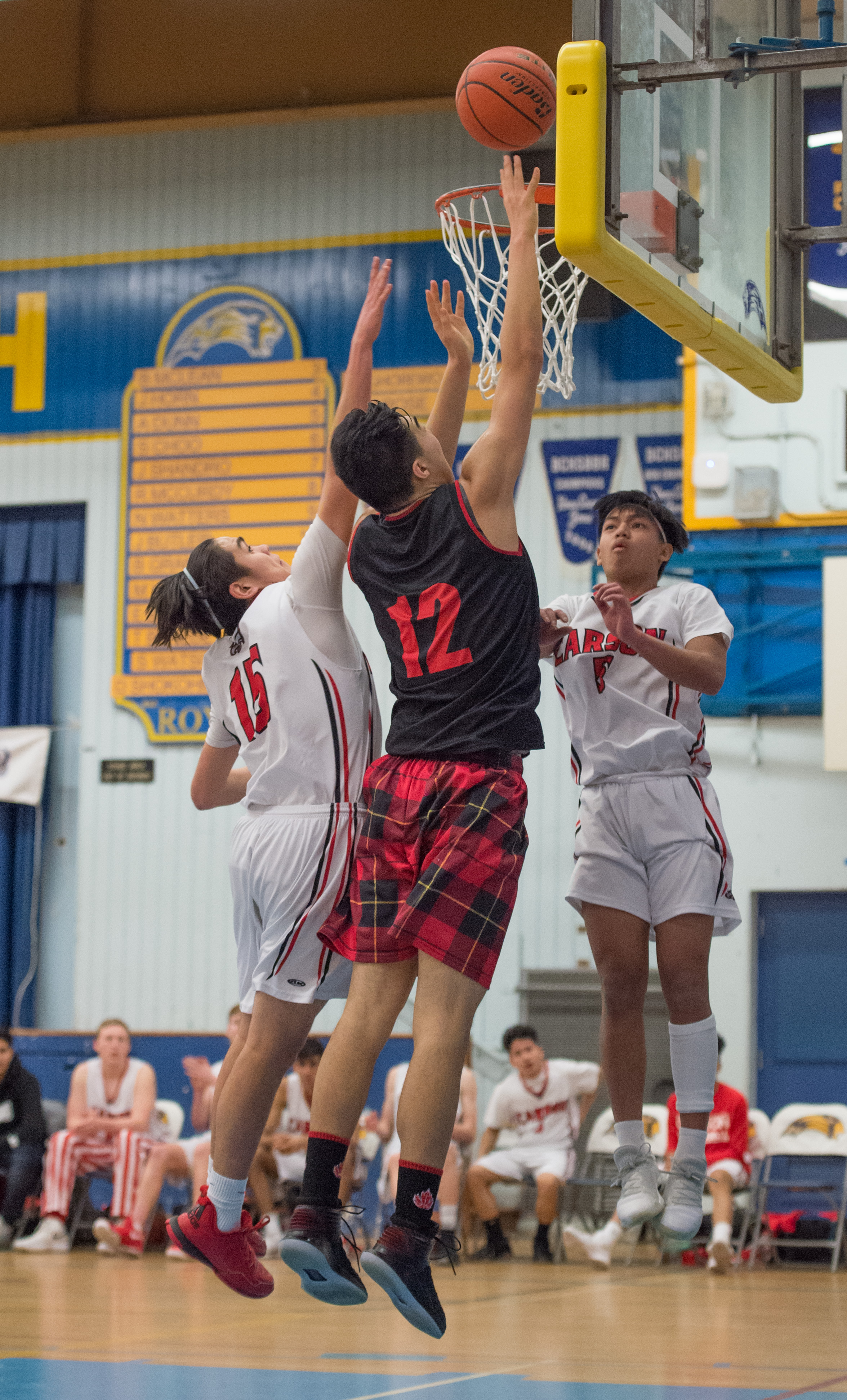 Kevin Li of the West Vancouver Highlanders drives to the hoop for 2 of his game high 29 points
