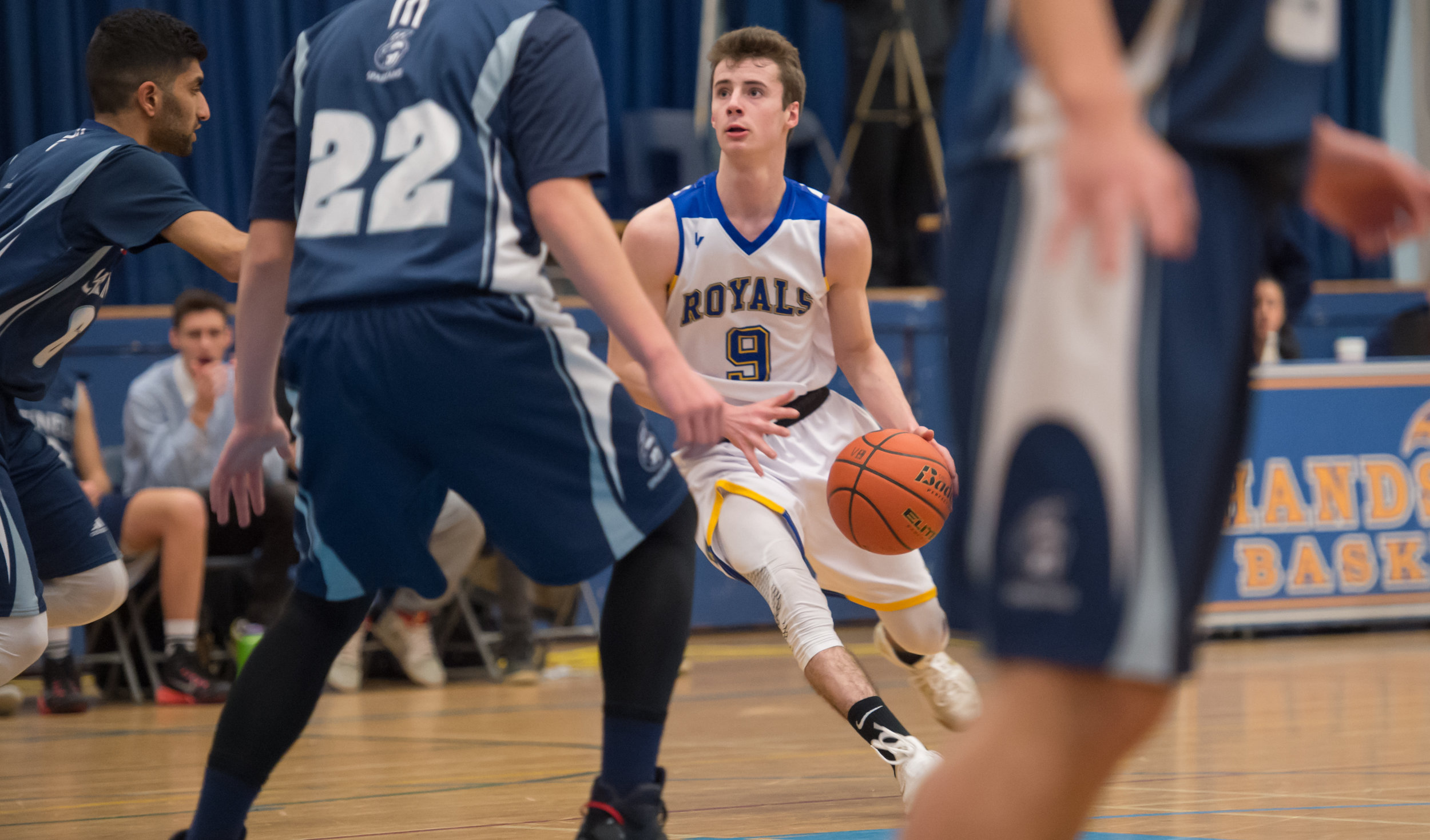 Handsworth's Player of the Game, Nate Watters pulls up at the elbow for 2 of his 19 points during Handsworth's opening round victory over the Sentinel Spartans in AAAA Howe Sound action.