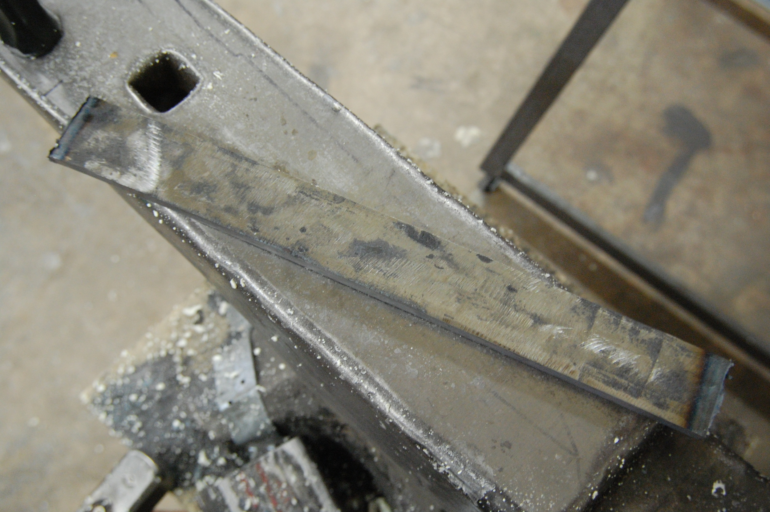 A billet that I forge welded and is currently at 88 layers of 52100 and 15N20.