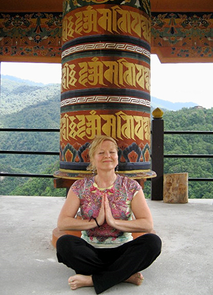 me in front of the prayer wheel.JPG