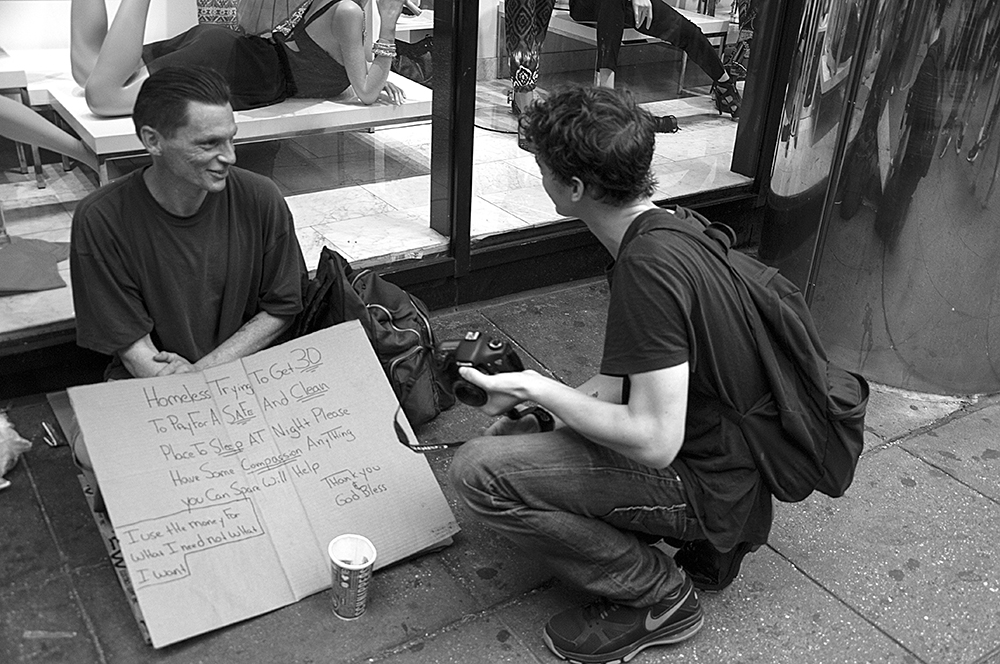 I have always been drawn to homeless people since I am always aware that any of us could be a day away from being there. In this instance I was out doing some street shooting with actor and great guy, Israel Broussard. I asked him if he had ever photographed homeless people and told him in doing so it's best to introduce yourself, have a conversation and ask them if they would mind if you took their picture. Oh, and always add something to the cup. In this instance, it was so amazing for me to witness their conversation where they both learned something from each other. And Israel got some great pictures.