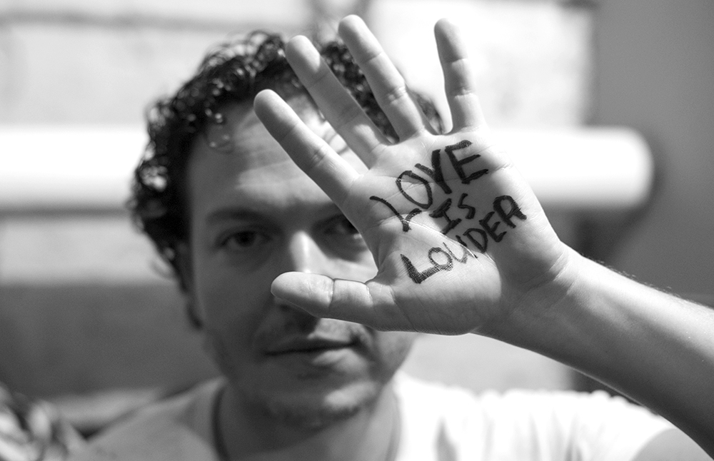 I was backstage with  Jay Stolar  shooting him while he was printing this sign on his hand prior to hitting the stage at the Mercury Lounge. He had recently aligned himself with the  Love Is Louder  movement. Check it out.
