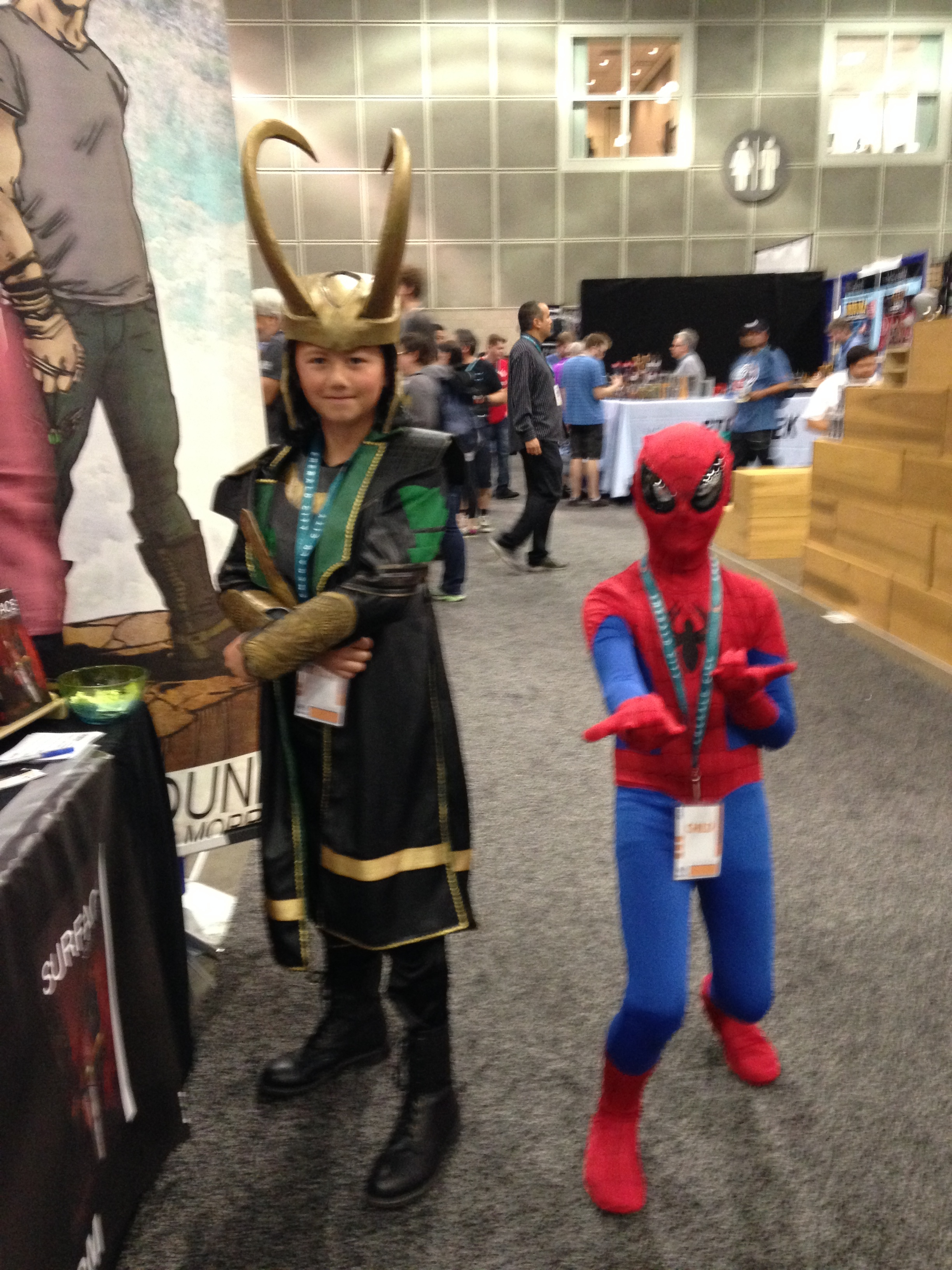 Children cosplaying Loki and Spiderman