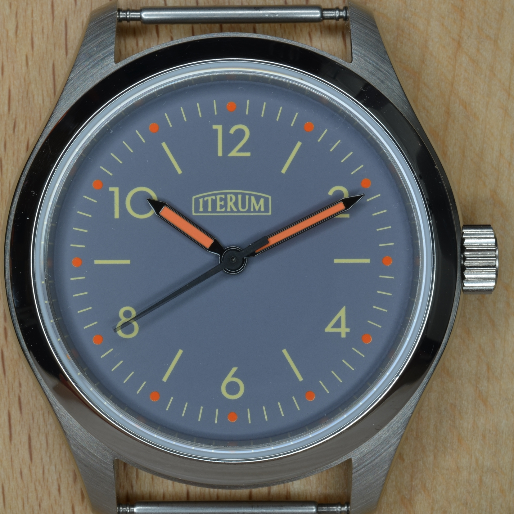 This dial has a blue-gray background and orange hour markers.