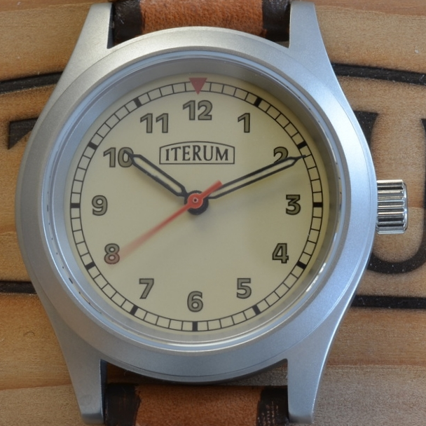 This dial has a beige background andrailroad track minute markers.