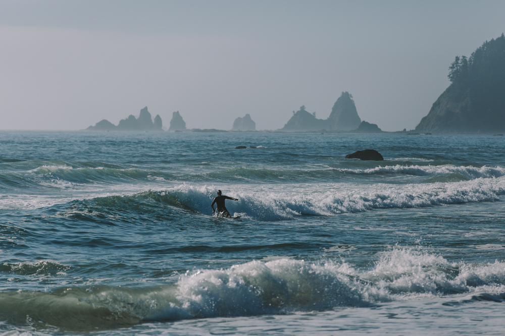 photo by Jess Hunter, Rialto Beach in Washington state, surfer on the Washington coast, Pacific Northwest surfing, Seattle elopement and wedding photographer, adventure elopement, adveture photography,