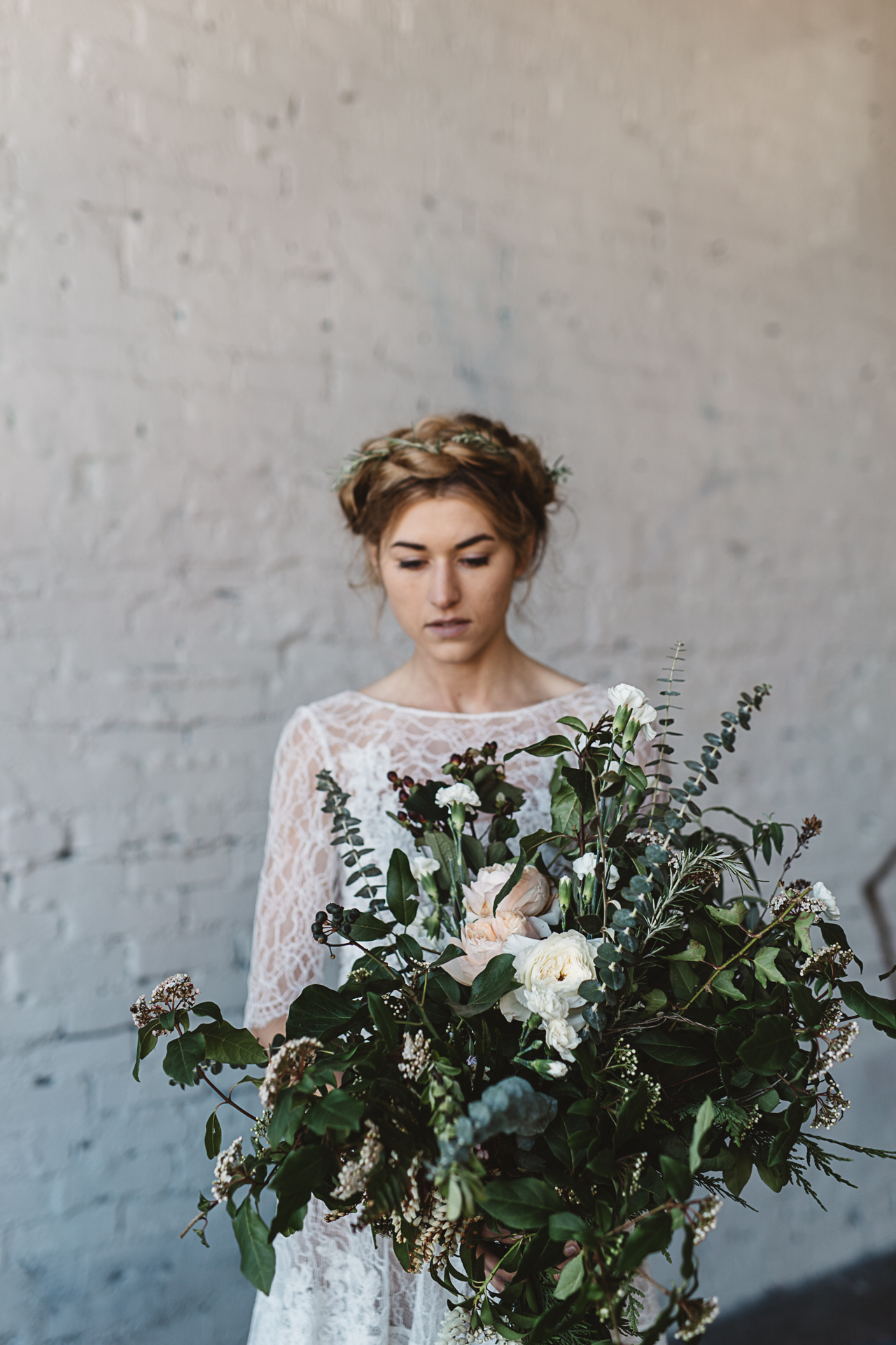 organic and industrial bridal inspiration by Jess Hunter, Seattle warehouse wedding inspiration, warehouse indoor wedding with greenery decor, wild foraged bouquet ina Seattle wedding, rosemary floral crown bridal style, modern industrial wedding