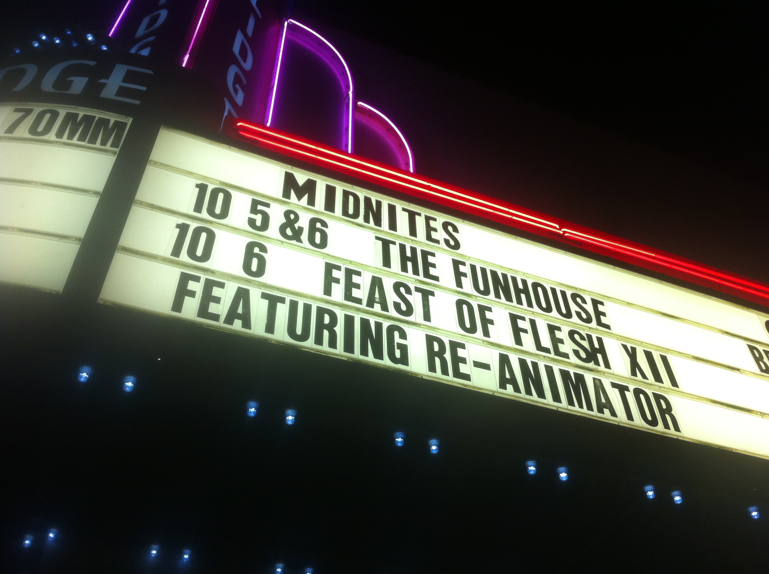 There was a point where I'd be at the theater so often that my iPhone background would always be my own picture of the midnite marquee outside the theater.