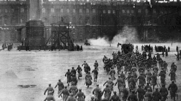 The same photograph before editing, showing the 'control tower' in the centre, and spectators in the Square. Source: State Central Museum of Contemporary Russian History / Inke Arns, Igor Chubarov, and Sylvia Sasse (eds.),  The Storming of the Winter Palace,  (Zurich: Diaphanes Press, 2016)