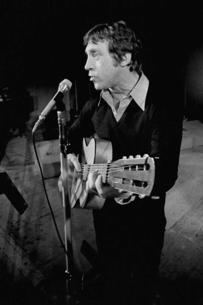 A photo of Vysotsky from 1979 at the Taganka theatre, playing his signature 7-string Russian guitar.