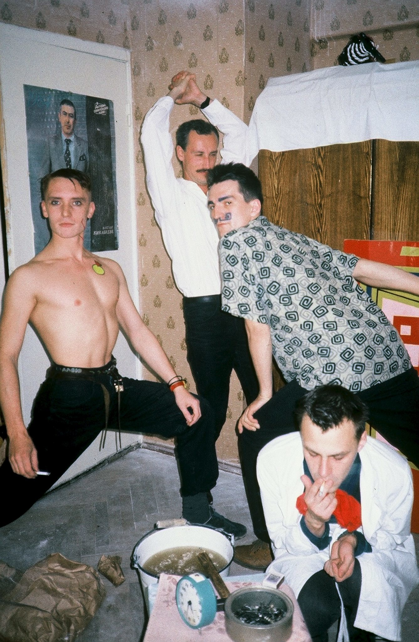 'The New Artists' (1987) — From left to right: Georgy Gurianov, Evgeny Kozlov, Timur Novikov, Igor Verichev. Taken at Kozlov's apartment in Peterhof. Image credit: Paquita Escofet Miro