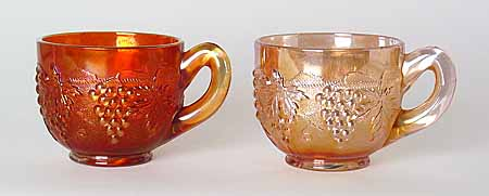 Both of these punch cups are marigold, but as you can see while the one on the right looks washed out, the one on the left has a much darker, more pleasing application of the marigold iridescence. The darker piece is much more desirable to a collector and is worth more.