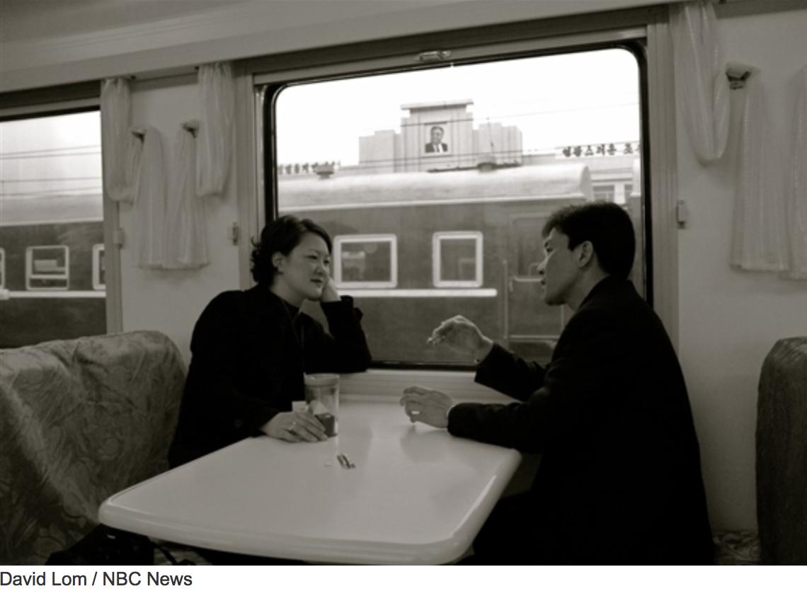 Jean on NKorea train.png