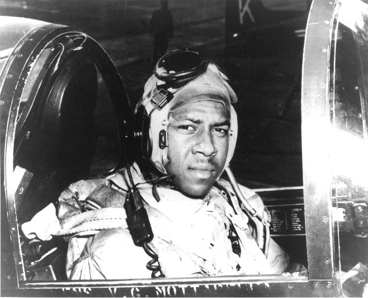 Ensign Jesse L. Brown, U.S. Navy. In the cockpit of an F4U-4 Corsair fighter, circa 1950. (Photo courtesy U.S. Navy)