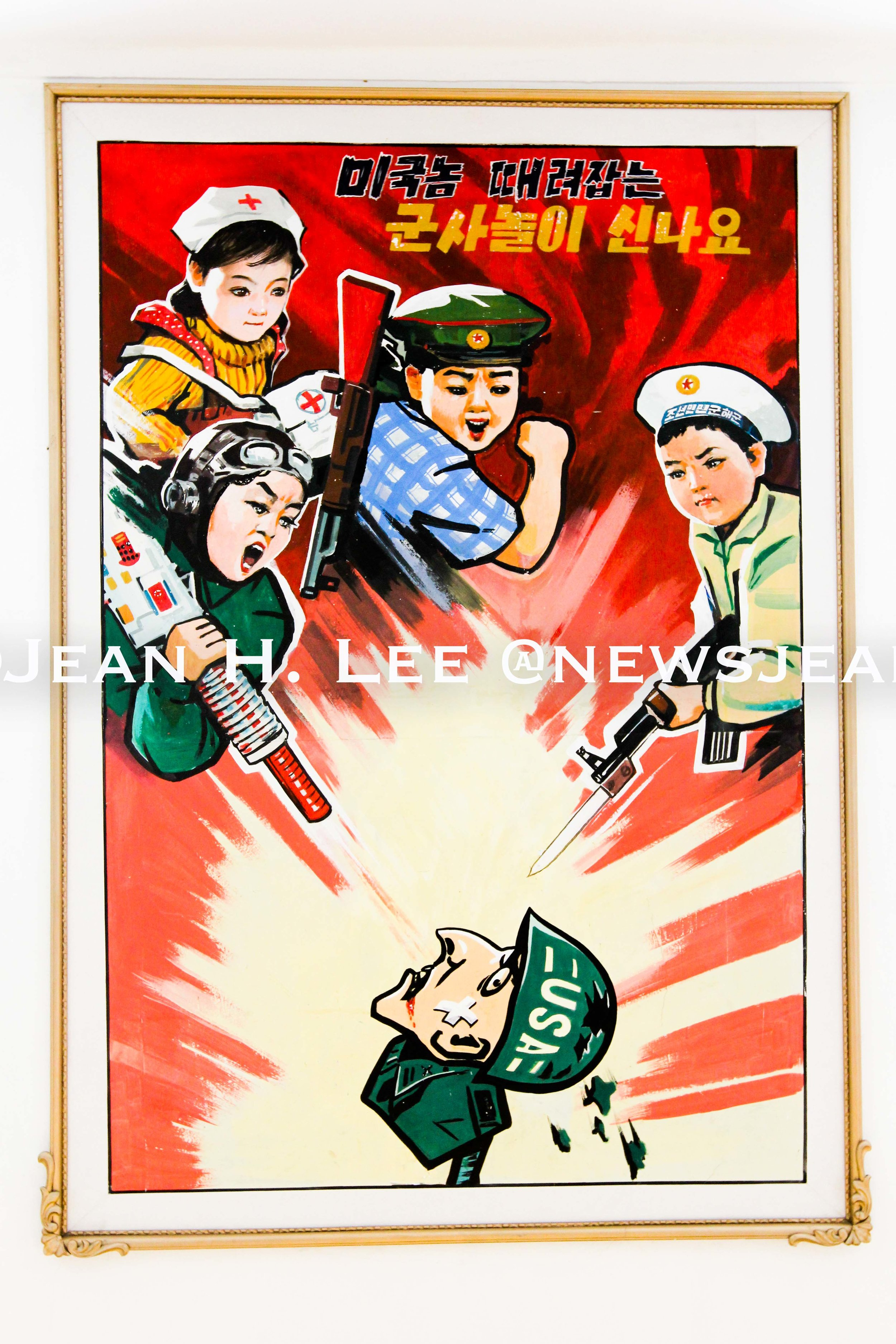 PYONGYANG, North Korea _ A poster on the wall at Kyongsang Kindergarten in Pyongyang, North Korea, depicting North Korean children attacking a U.S. soldier. (Photo credit: Jean H. Lee)