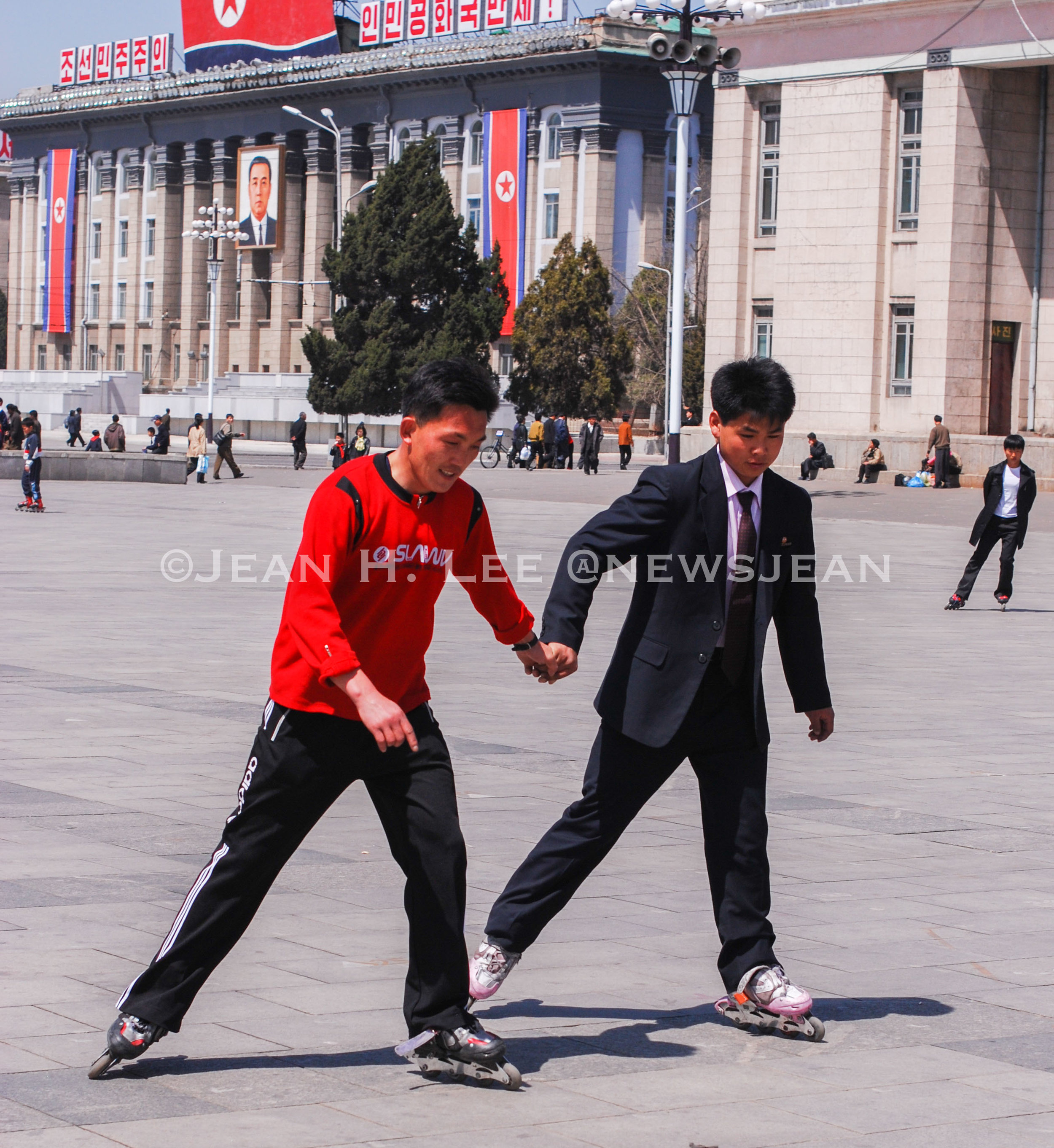 North Koreans inline skating on Kim Il Sung Square in Pyongyang. Photo credit: Jean H. Lee. All Rights Reserved.