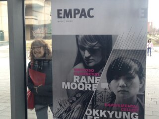Large face/small face - next to an advertisement at EMPAC