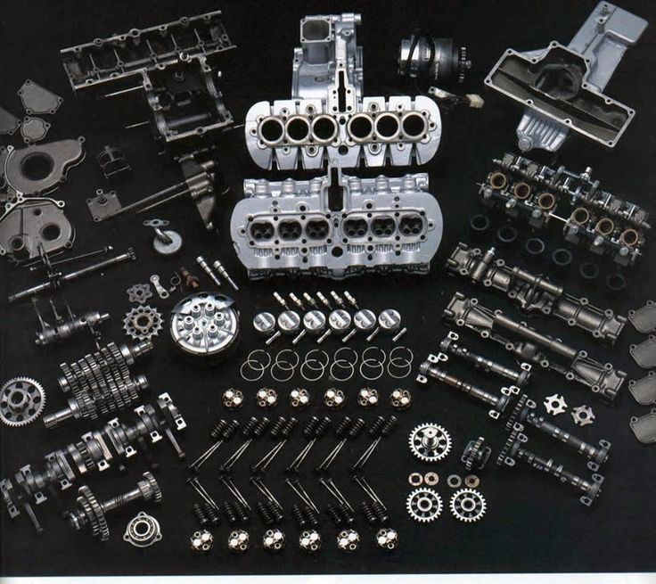 """The contents of the RC166 engine. Consider for scale the block is 14"""" across, and a piston is 1.6""""."""