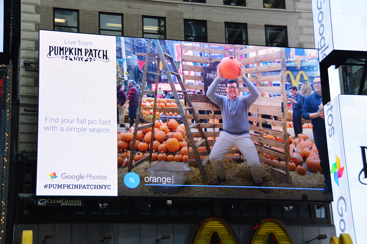 ...and see it pop up on a Times Square billboard with a search term they could use to find it later in Google Photos.