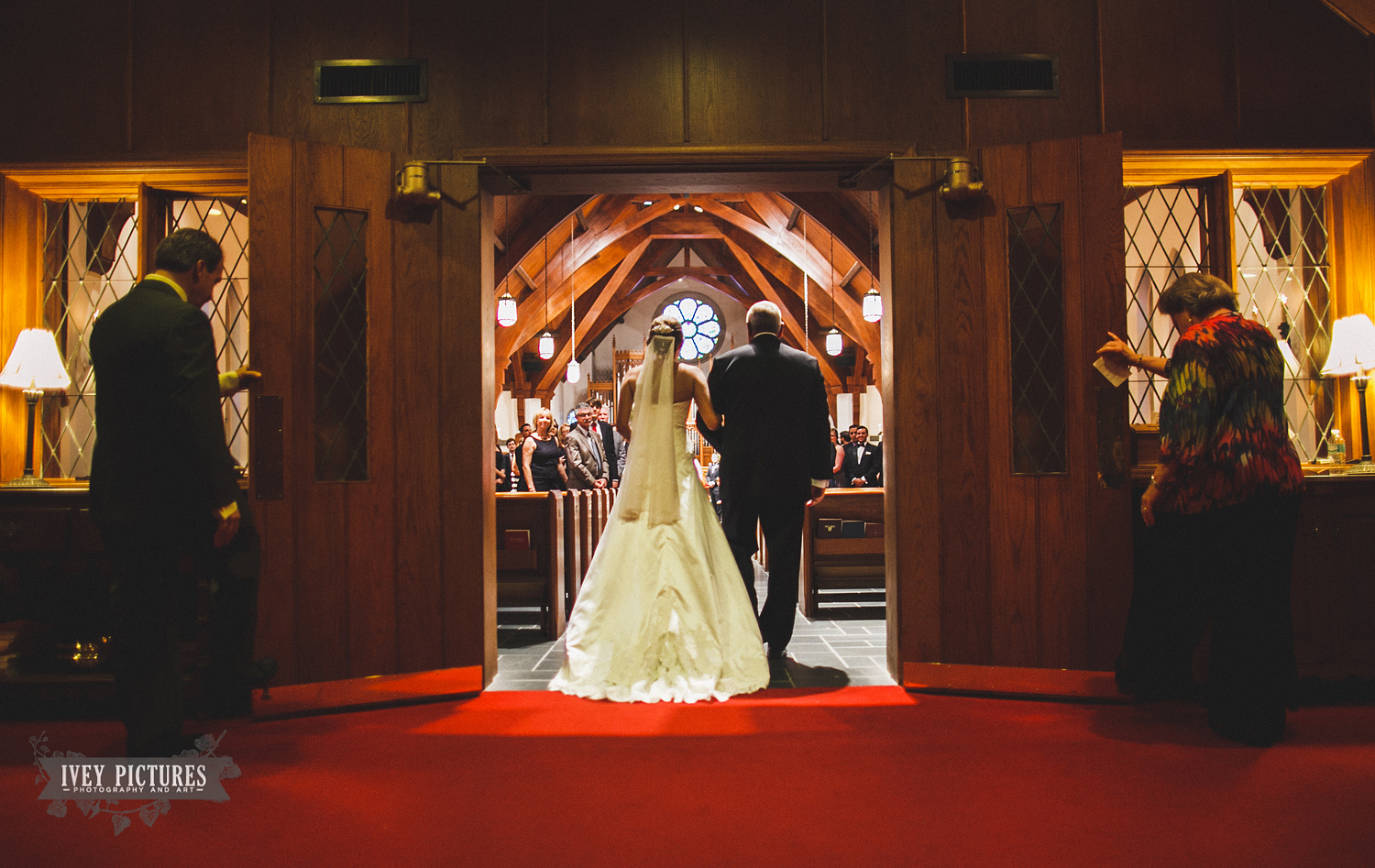 bride walking down the isle at St Marks Episcopal Church Jacksonville