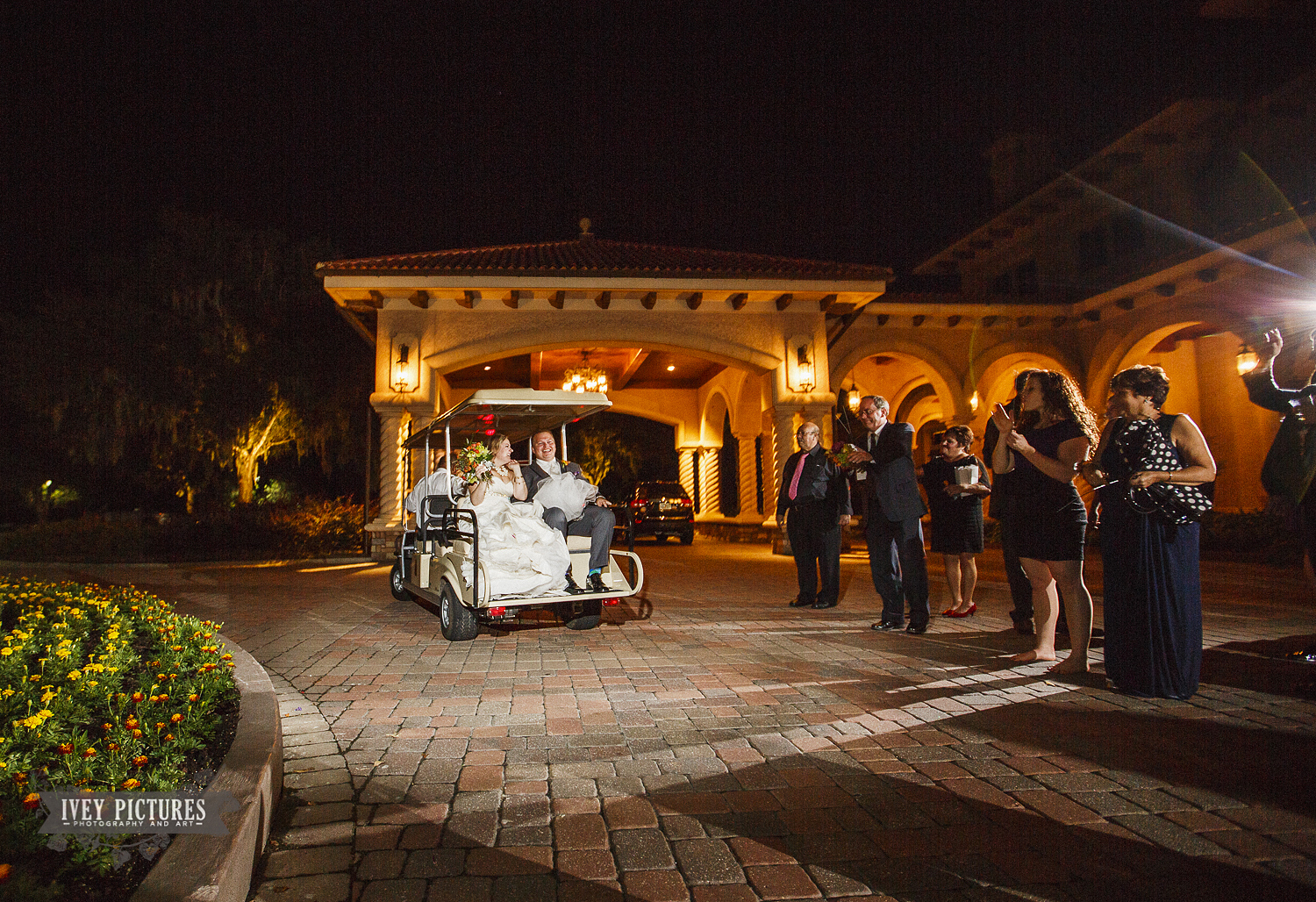 bride and groom leaving wedding on a golf cart
