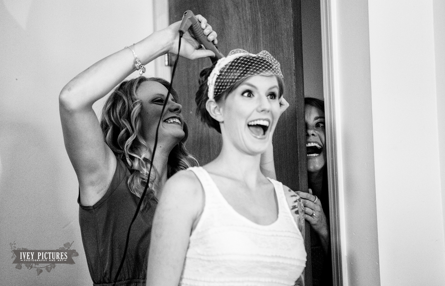 candid photo of bride getting ready