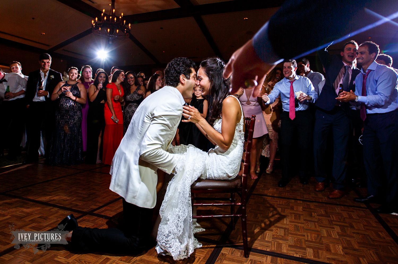groom removing garter at wedding