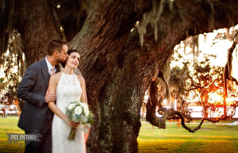 bride and groom under oak tree.jpg