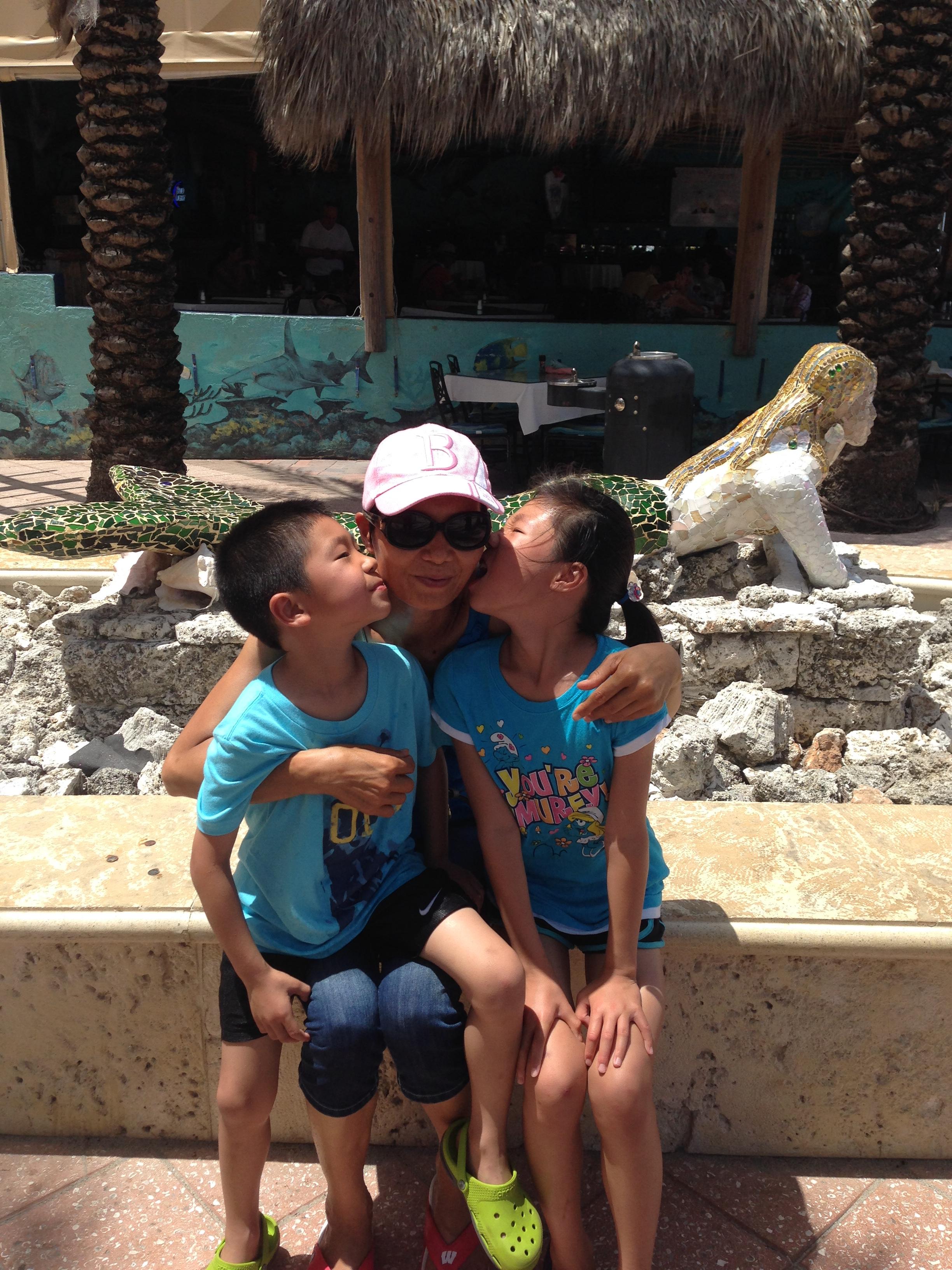 MOM KIDS KISSING.JPG