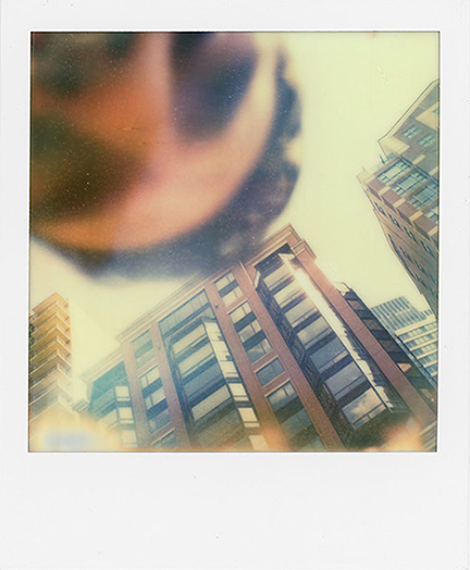 Accidental Self Portrait While Attempting to Fix the Shutter on my Polaroid SX-70 . 2012.