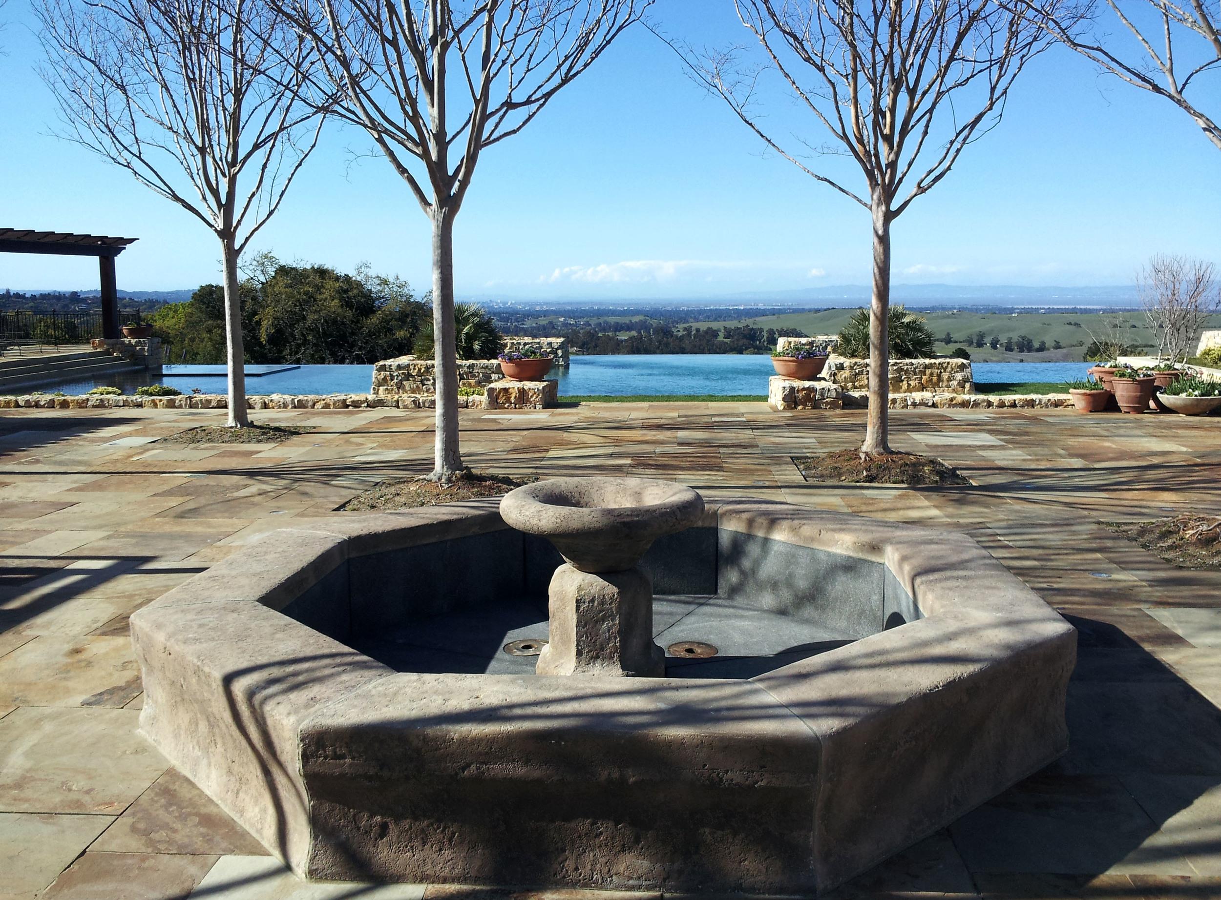 fountain in limestone with granite basin