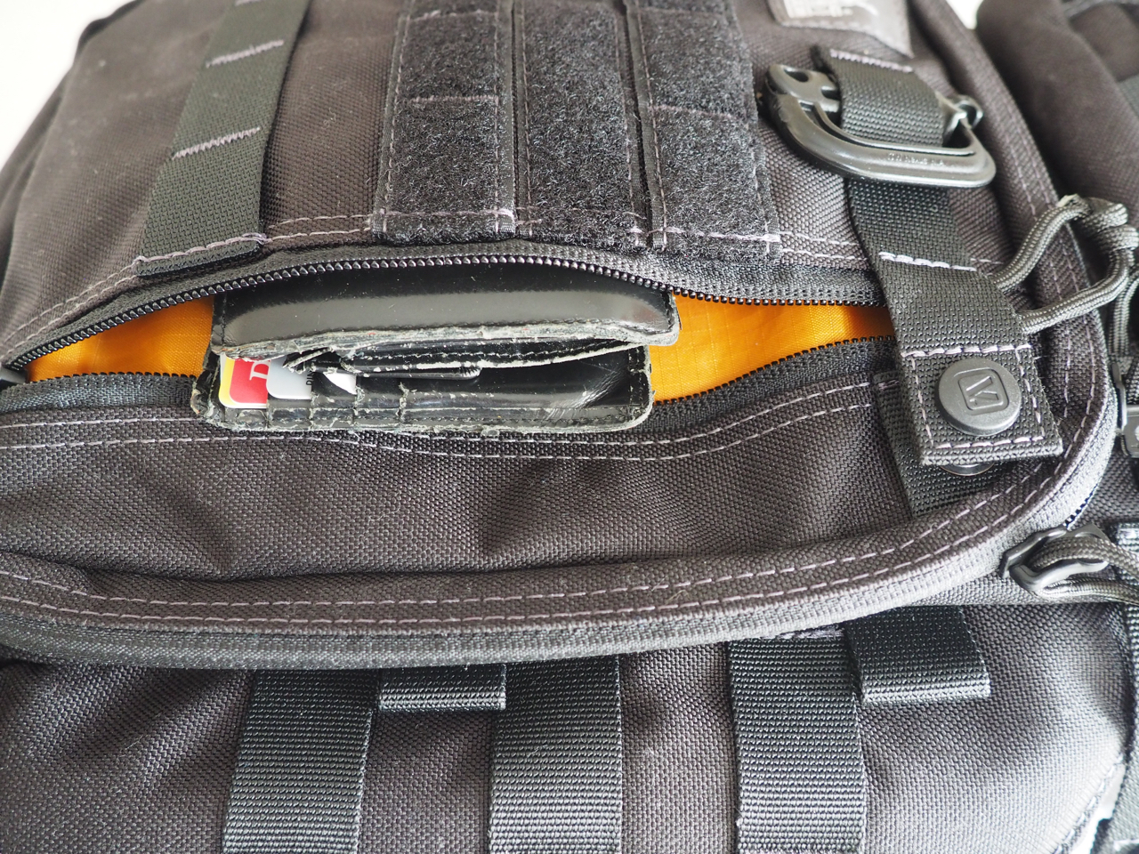 "Wallet in the front zip pocket, ""lockable"""