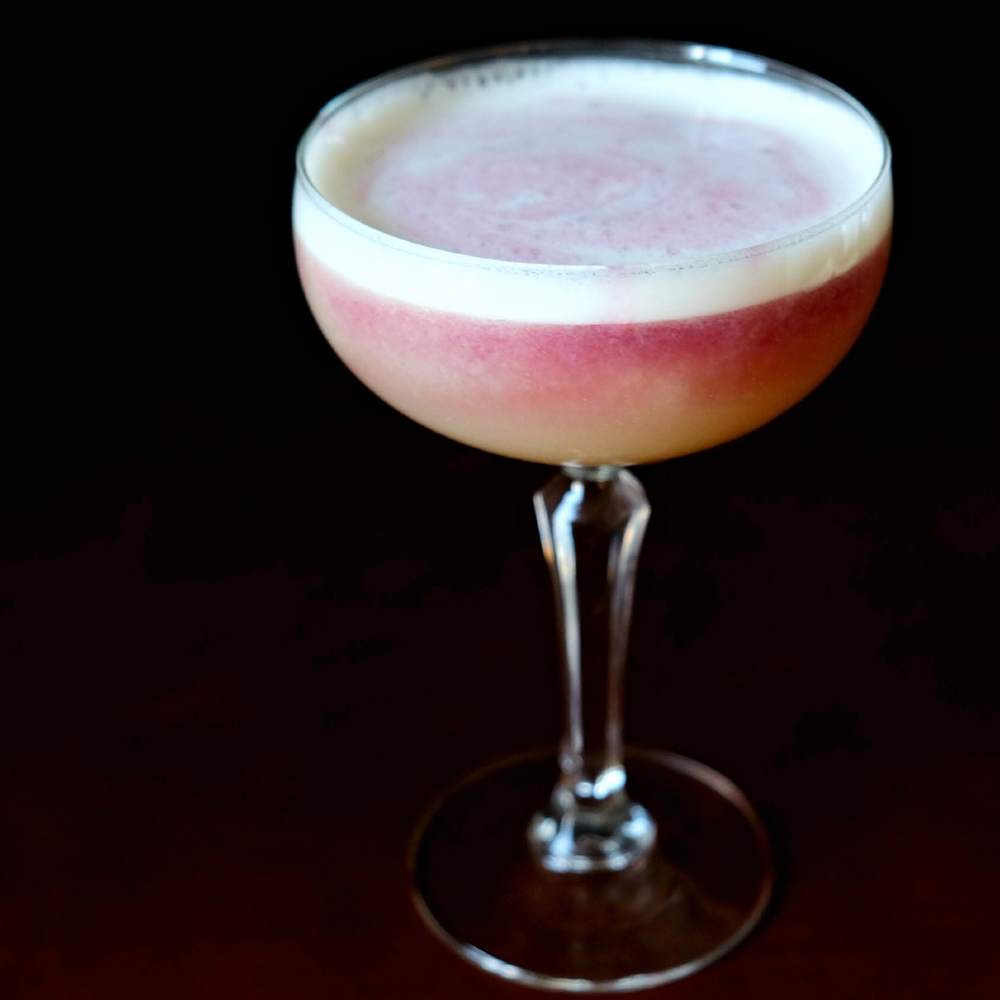 New York Sour - A whiskey sour made with egg white and a red wine float.