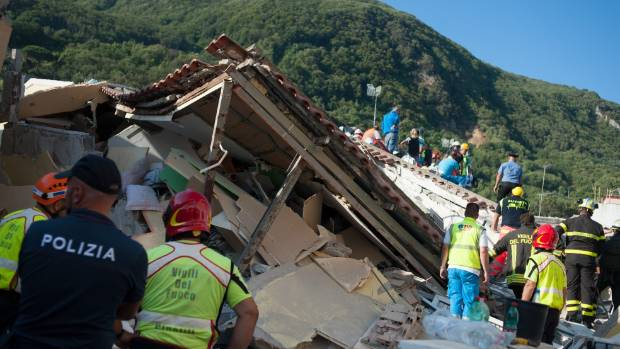 Rescuers dig through the rubble during a search for two missing children in Casamicciola Terme, Italy, after a magnitude-4.0 earthquake struck in August.