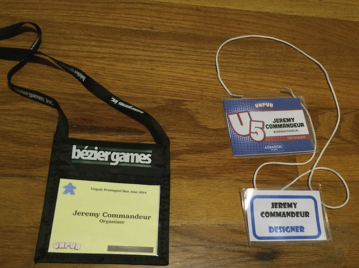 Inexpensive badge (lower right), nice badge (upper right) and super nice Bezier lanyard (left).