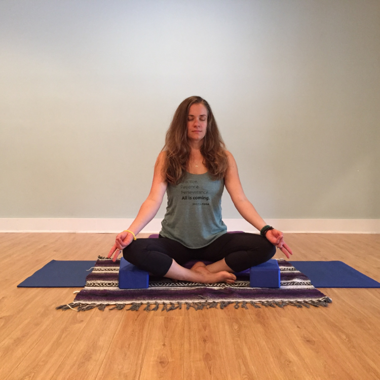 Demonstrated here is a traditional method of meditation, finding a comfortable seat with eyes closed. Here,Shelly holds the pranayama mudra, touching the ring and pinky finger lightly to the thumb, as she focuses on her breath.